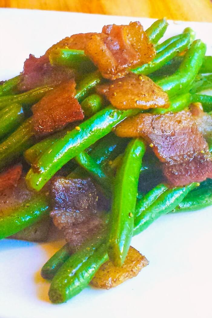 This Balsamic Bacon Green Beans recipe, glazed with balsamic vinegar and bacon, is a great alternative to the traditional Thanksgiving green bean casserole. ~ http://FlavorMosaic.com