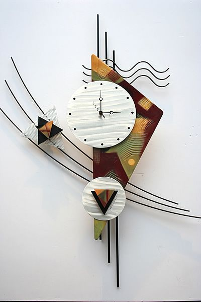 This contemporary metal wall clock sculpture is a great design with clean lines and makes a great look on any wall. The black frame is welded steel construction with a brushed metal art clock face