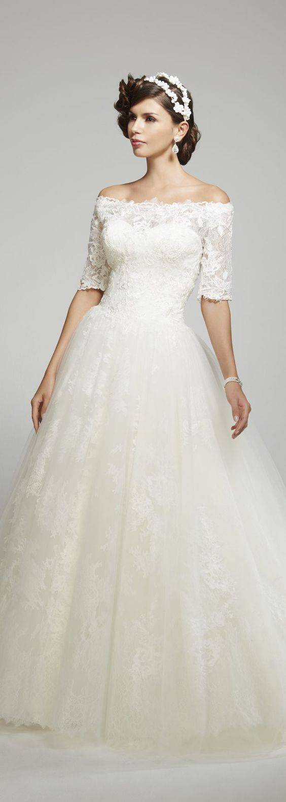 Lovely lace off-the-shoulder tulle skirt ballgown wedding dress; Featured Dress: Matthew Christopher