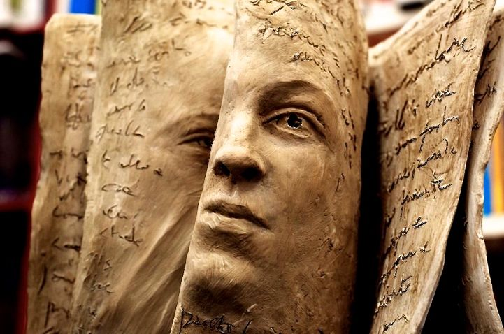 """Both faces and books tell stories, and perhaps that's why Italian artist Paola Grizi's terracotta sculptures are so captivating. Grizidoes an excellent job conveying deep emotions through the expressions on each face. """"Sometimes the faces emerge from the material are as epiphanies of the consciousness,"""" she says on her artist statement. According to Grizi'swebsite, she developed her love of art when she was still a child, while watching the work of her grandfather, painter and sculptor. In…"""