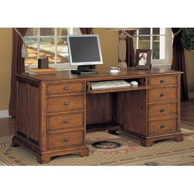 Halton Hills Executive Desk by Wynwood Furniture. $839.99. Lifetime Warranty. 1231-34 Features: -Executive desk.-Beaded moldings.-Drop front keyboard drawer with pencil tray.-Two storage drawers.-Two drawers with removable drawer dividers.-Two fully extending file drawers accommodate letter/legal hanging files.-Transitional knob hardware.-Cable accessible. Construction: -Constructed of quartered oak veneers with ash solids. Dimensions: -Overall dimensions: 30'' H x 66'' W x ...