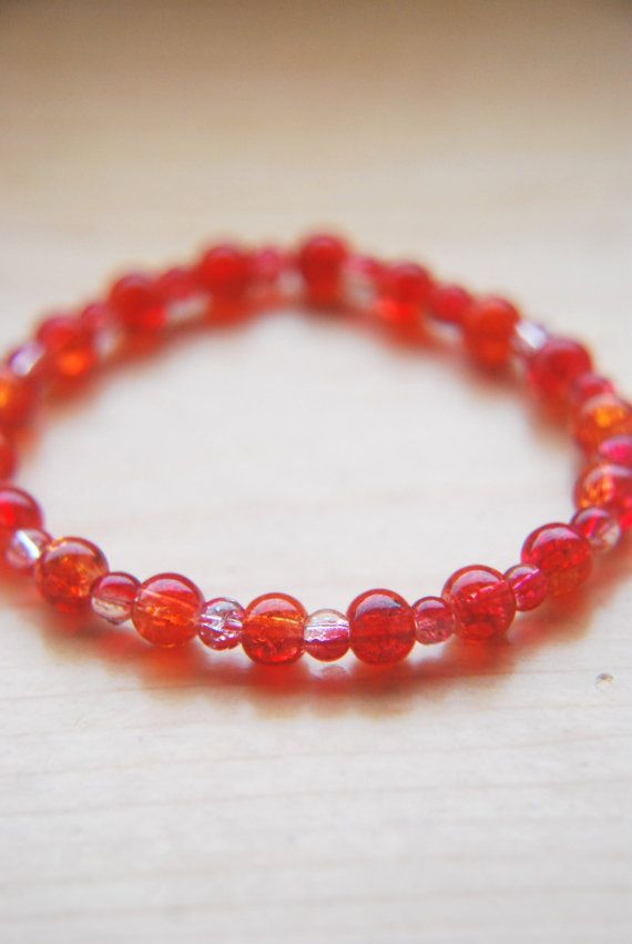 Hey, I found this really awesome Etsy listing at https://www.etsy.com/listing/205431686/red-orange-beaded-bracelet-stretch