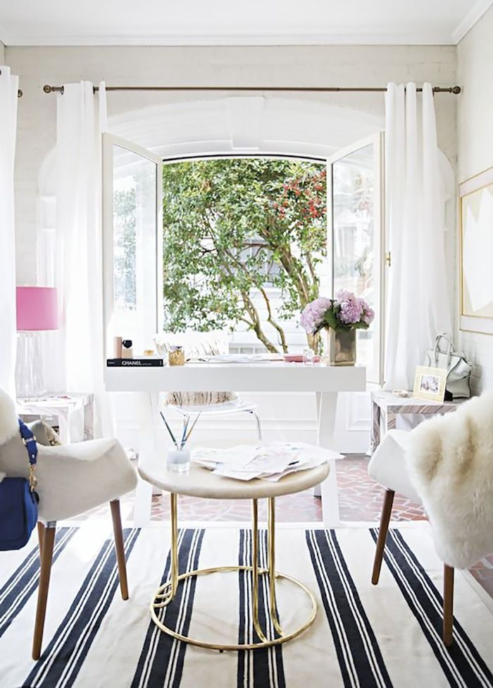 Gorgeous feminine office.  Love the striped rug and charming window.