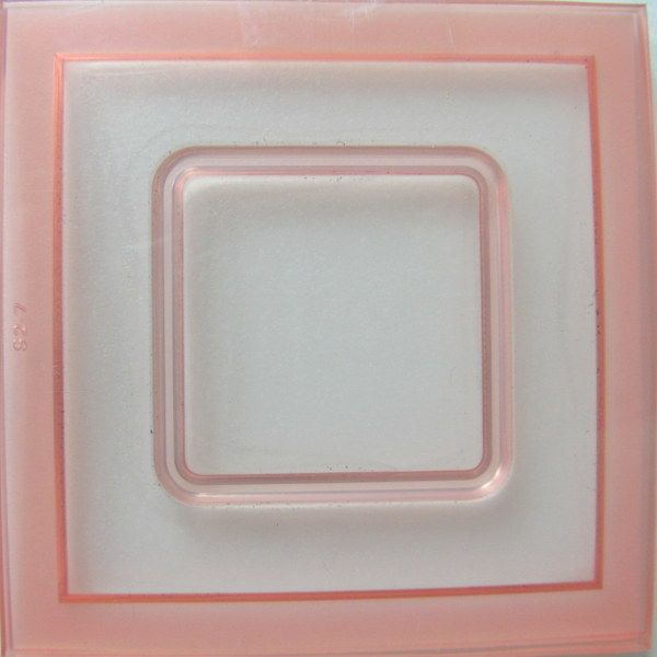 Rounded Square All-in-One CaBezel Mold The All-in-One CaBezel Molds are different from the 'Original' series of CaBezel molds. Use the A-I-O once to create the background or base of your piece. Use it again, concentrating on the inner area to create the cabochon. Cut around the cabochon and place onto the demarked area of your baked base. Everyone needs the basic shapes and this one fits the bill. It measures 1½' and sits inside a square customizable bezel that measures 2½' x ...