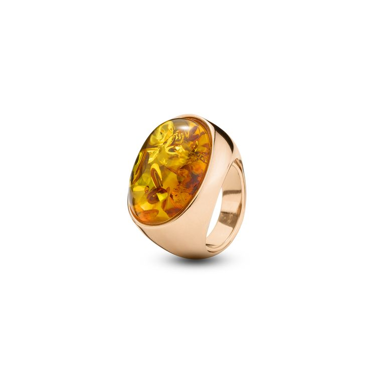 House of Amber - A graceful ring in rose gold sterling silver ring and cognac amber. The ring has a timeless design and is a part of the Enlightened Enamel Collection.