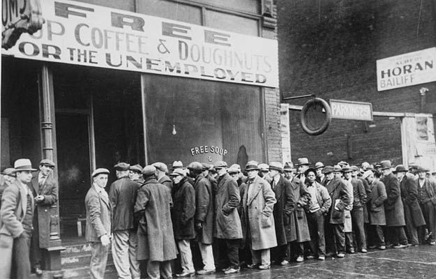 This is a photograph of unemployed men standing in line, waiting for free food in order to keep themselves healthy. This demonstrates how difficult times were during the great depression  and gives an idea on how many people were unemployed. It is a credible source because it is a picture from the time period and tells a lot about what canadians were going through at the time.