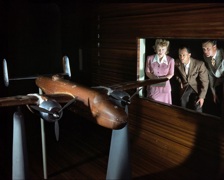 "October 1942. Experimental staff at the North American Aviation plant in Ingle- wood, Calif., observing wind tunnel tests on a model of the B-25 (""Billy Mitchell"") bomber. 4×5 Kodachrome transparency by Alfred Palmer."