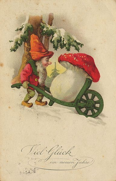 Christmas Gnome with wheelbarrow and mushroom