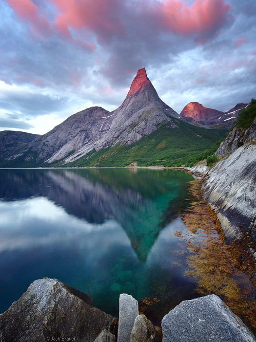 """Tysfjord, Norway  Stetind is a remarkable peak in Norway (Norway's """"national mountain"""" in fact) rising abruptly 1392m (4564 ft.) above an arm of the Tysfjord southwest of the town of Narvik, in northern Norway."""