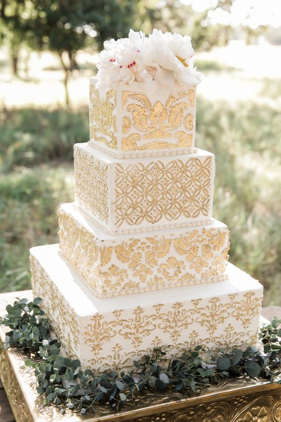 Featured Photographer: Breanna McKendrick; Sophisticated four tier gold detailed white square wedding cake