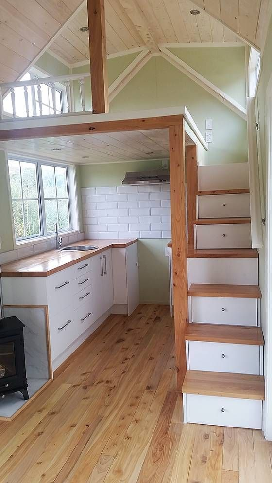 green tiny house - I like the use of space, the stairs with storage, and the fact that the loft is high enough to stand up in! So much light from windows ~ lovely