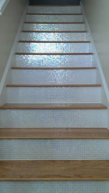 "Mosaic Glass Tile Backsplash on stairs in ""White Cloud Glimmer Glass tile"" stair risers...Stunning! Found at https://www.subwaytileoutlet.com/"