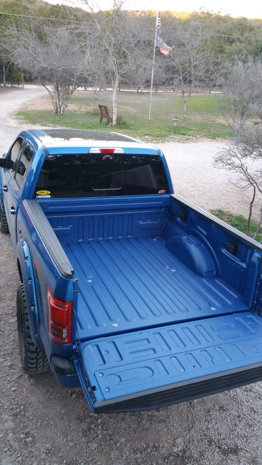 LineX spray bed liner matching the color of Freedom truck