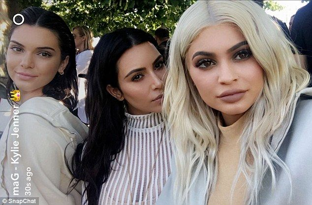Family affair: Kendall, Kim and Kylie snapped a selfie as they arrived at…