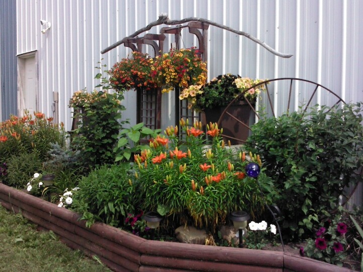My rustic flower bed flower beds pinterest wheels antiques and beds - Rustic flower gardens ...