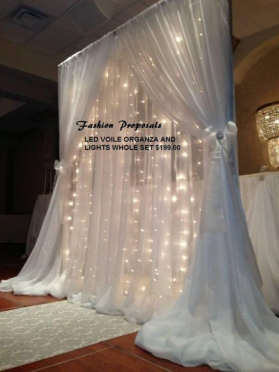 LED COMPLETE BACKDROP SET WITH LIGHTS AND FABRIC. THIS LED CURTAINS WILL ADD SOME ELEGANT AND GLOWING LOOK TO ANY EVENT, RECEPTION OR CEREMONY
