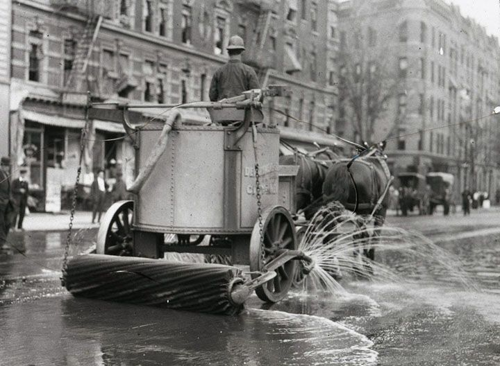 A two-horse team street cleaner, with sprayer, squeegee, and roller at rear. (Courtesy NYC Municipal Archives)