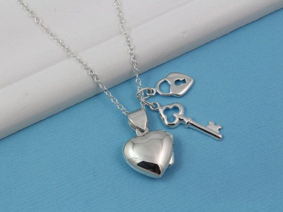 Heart locket, Solid Sterling Silver Heart Necklace. Truly Heirloom Silver Locket jewelry . Engraving service:....................................... http://etsy.me/2zhDhsy . Take a look at other Locket designs:........... http://etsy.me/XKqYt8 . Browse through this