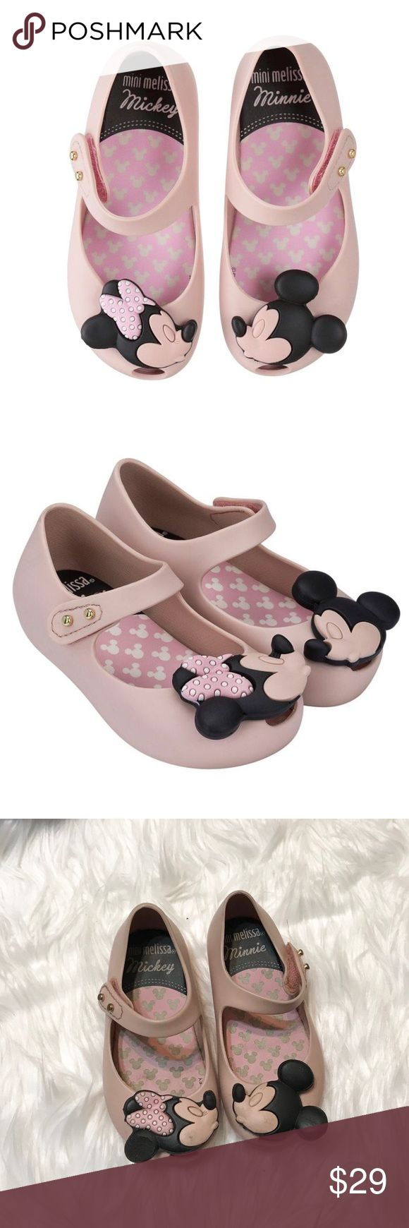 Mini Melissa Ultragirl Disney Twins Light Pink Ultragirl Disney Twins Mary Jane Jelly Flat (Toddler size 7) in Light Pink. These are in Used condition, they were worn a lot & you can see my daughter bit a part of the Minnie Mouse ear. Some dark marks also so please be aware of the flaws. Minnie & Mickey Mouse kissing detail. Made in brazil, 100 percent recyclable plastic. Mary Jane fashioned from waterproof & fruit-scented PVC, while an adjustable hook-and-loop strap allows for easy on…