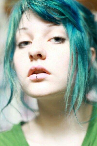 Blue green hair and pierced lower lip