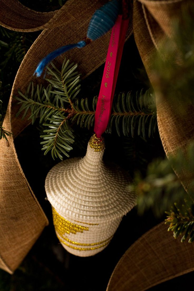 Decorate your home for the holidays while supporting Rwanda - this ornament was inspired by traditional Rwandan design, intricately hand-woven using centuries-old techniques. Sale fo this basket enables a weaver to feed and educate her children, gain access to healthcare and assume leadership in her community. This basket was hand-woven by Mukeshimana #Path2peace @macys