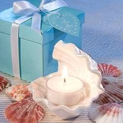Give your wedding guests a chance to go beachcombing without ever leaving their tables with these exceptional shell design candle wedding favors.  Just like a real oyster shell, this exquisite open shell design beach wedding favor has a treasure inside.