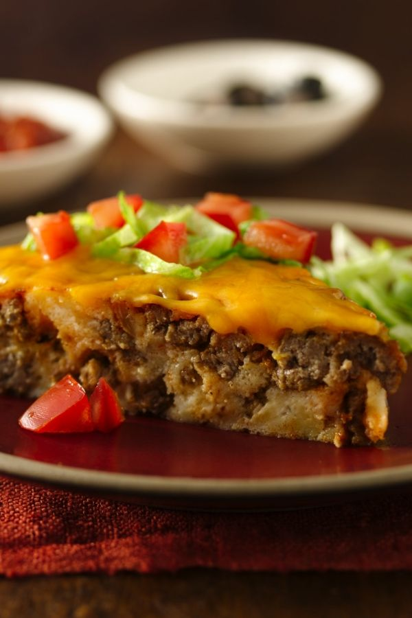 Enjoy this impossibly easy taco pie recipe made using taco seasoning mix and chopped green chiles that are ready in just 50 minutes – perfect for a dinner.