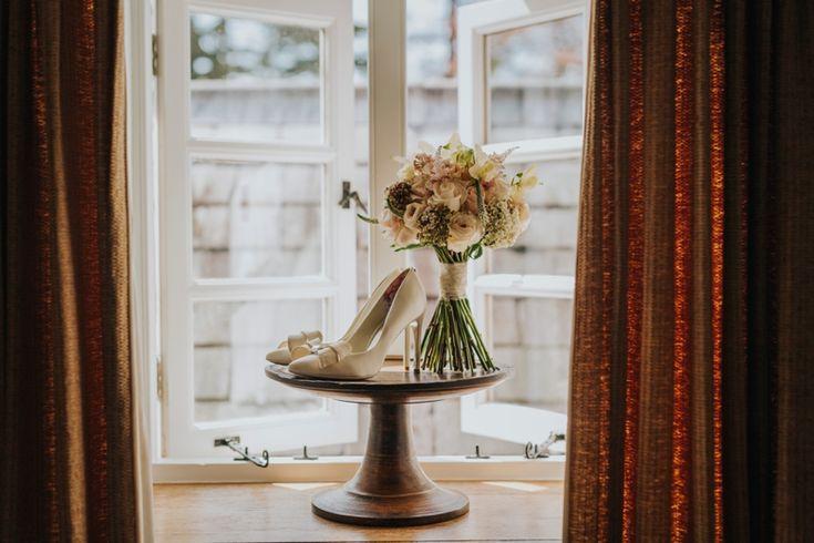 Stylish bow-detailed bridal shoes and flowers by @whfco. Photo by Benjamin Stuart Photography #weddingphotography #whitehorseflowercompany #bridalshoes #weddingflowers #bows #weddingideas #bride