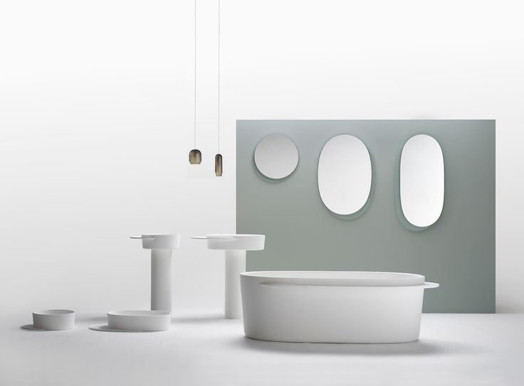 """Sebastian Herkner's modern bathroom collection for ex.t features overhanging """"plateaus"""" for storage that almost resemble shadows."""