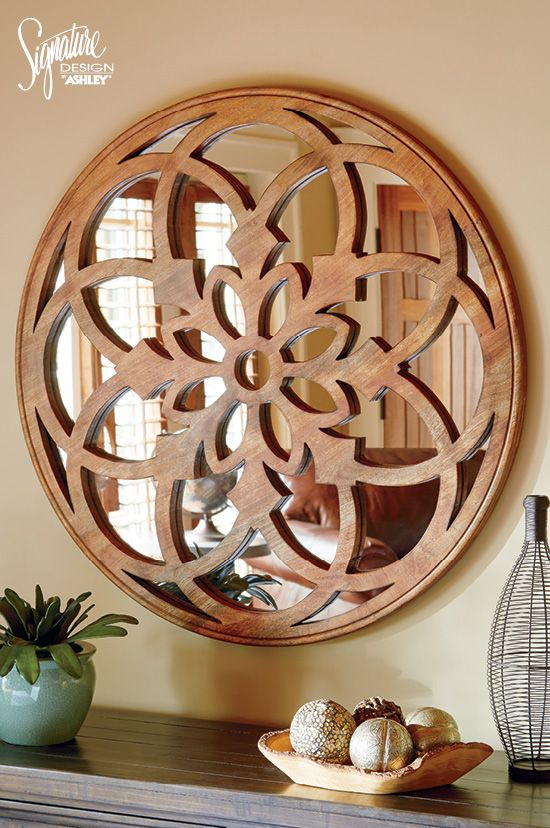 Add the perfect balance of rustic and elegance with our burnished natural finished carved wood mirror. This sophisticated floret design is taken to a more casual level with the wood finish, giving you the perfect finishing touches to any wall! #AshleyFurniture - Wall Art, Décor & Mirrors - Ashley Furniture - Home Accessories