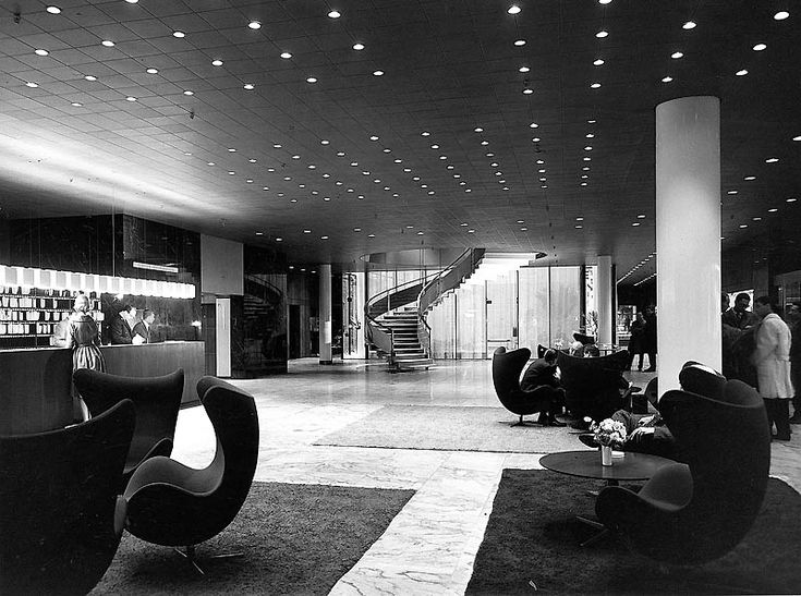 Arne Jacobsen iconic Egg chairs creates small secluded islands with in the lobby at SAS Royal Hotel, Copenhagen