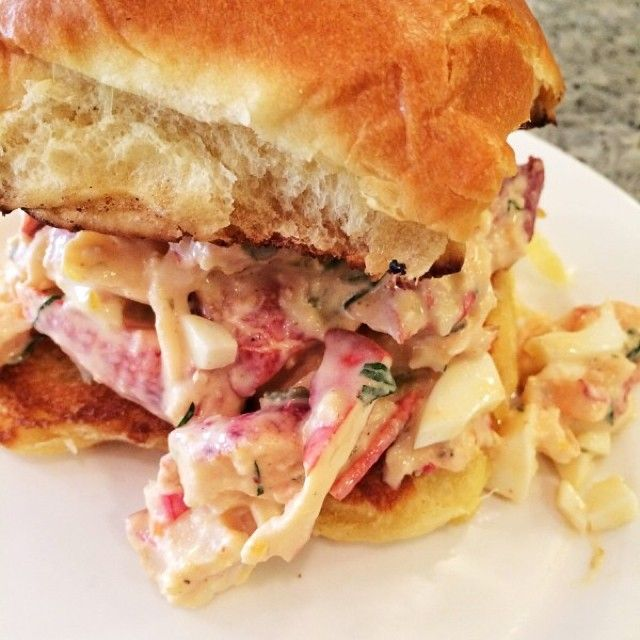 Lobster Salad 1/4 cp mayo 1 tsp horseradish 1 tsp Tabasco 2 tsp lemon juice 2 tsp ketchup 1 tbs Dijon mustard 1 tbs drained, chopped cornichons 1 tbs drained capers, smashed 1 hard boiled egg, chopped 1 1/2 tbs chopped fresh parsley Salt and pepper 1 lb chilled cooked lobster meat, chopped  In a small bowl combine the mayo whorseradish, Tabasco, lemon juice, ketchup, Dijon, cornichons, capers, boiled egg, and parsley.  Season to taste with salt and pepper.  Gently fold the lobster meat in.