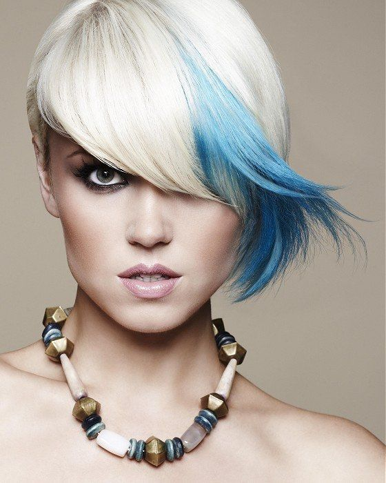 Short blonde asymmetrical bob haircut with a streak of bright blue coloring hairstyle