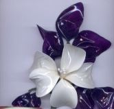 clayalley.com - Dip it, the art of dipping looped wire into resin and creating flowers, wings and more.