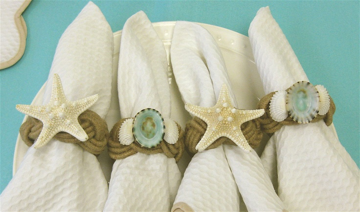 "Add Beach Style to your table with these pretty Jute Rope Napkin Rings.  Two have natural Starfish and two have my favorite blue-green Limpet shells with white arc shells on either side.These would make a great gift for the beach lovers on your list!1"" x 2-1/2"" diameter4 included. $24.00"