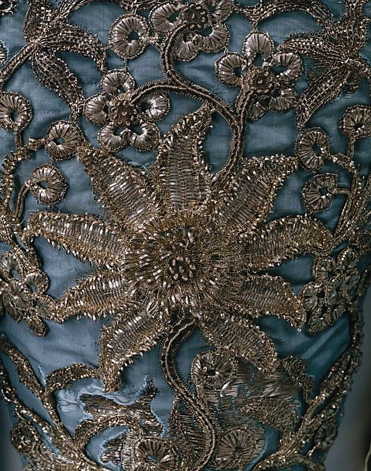 Detail stomacher, court mantua, Great Britain, c. 1750. Blue silk brocaded with silver floral sprays and floral metallic-thread embroidery.