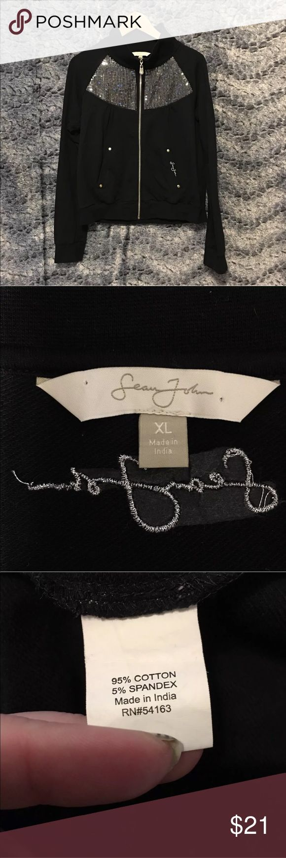 Sean Jean Women's Jacket Size XL Black Sequin JLO Sean Jean US Women's XL The jacket has clear but reflective sequins. There are 4-5 sequins missing but it is not noticeable. The black of the jacket is faded a little. Please look at the measurements!  Shoulder   17 inches from shoulder seam to seam straight across back Sleeve   32 inches from center back of the shirt to the end Length   22.5 inches from the center base of the back of the collar to the end of the shirt Chest   20 inches x 2…
