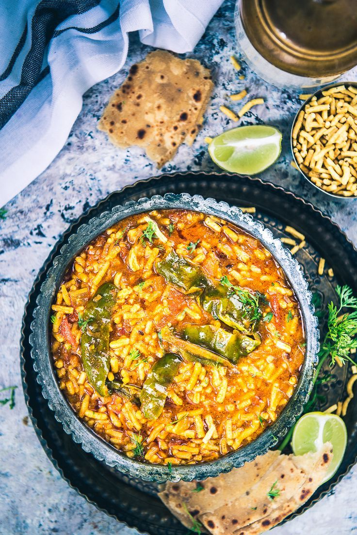 An incredibly humble accompaniment, Rajasthani Sev Tamatar Ki Sabzi is made using juicy tomatoes, desi masalas and served with heaps of besan sev. #Indian #Vegetarian #Rajasthani #Gujarati #Vegan #GlutenFree