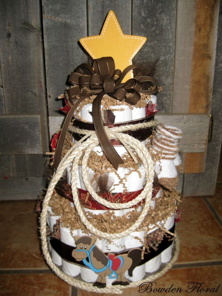 diaper cake, western   ... diaper cakes the first cake was for a baby shower for a western themed