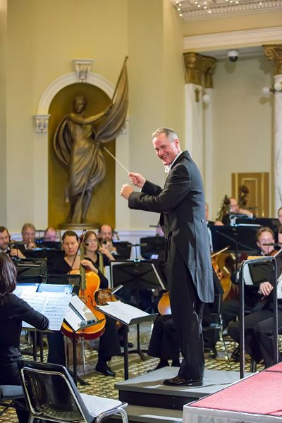 Governor Daugaard tries his hand at conducting the South Dakota Symphony Orchestra at their concert at the South Dakota State Capitol on November 1, 2014. Photo by Keith Hemmelman.