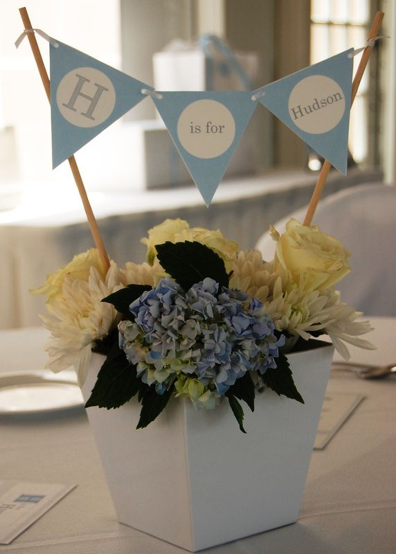 Easy Baby Shower Centerpiece with mini pennant banner attached to two wooden dowels