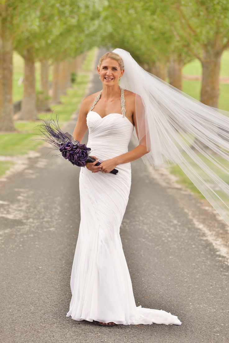 Our stunning Silver Ferns Captain Casey Williams on her wedding day with her Flaxation cascading bouquet in purple with silver ferns.  www.flaxation.co.nz