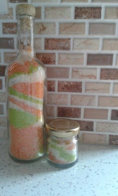 Glass bottles and containers filled with gake coloured sand!