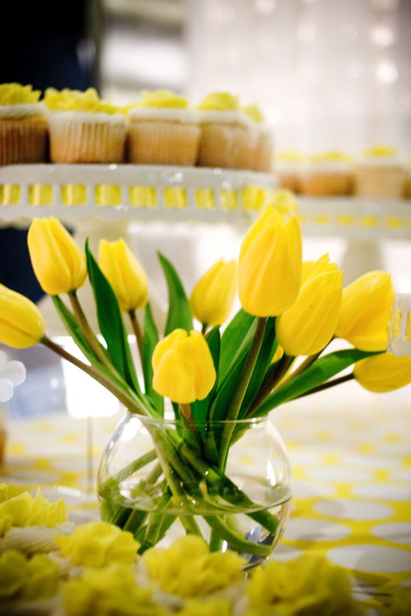 A simple yellow tulip display for a beach wedding in the spring.
