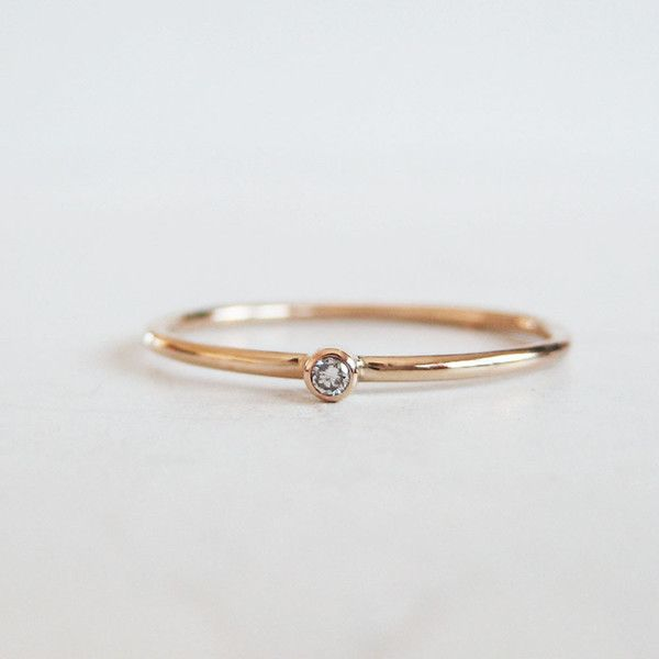 The tiniest and cutest little diamond ring ever. When you want just a little sparkle this ring's got you covered. A white 1.5mm recycled, G/H, SI diamond is bezel set atop a 14k recycled gold band. We