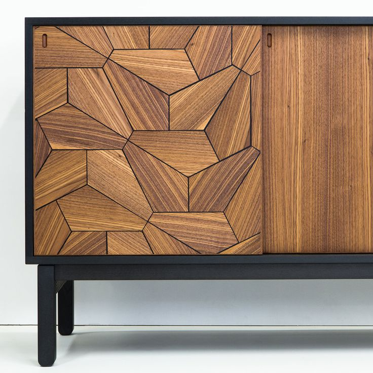 The focal point of this cabinet are sliding doors covered in an intricate pattern of pentagonal wood tiles. Black resin inlay fills the spaces between the tiles to create a strong graphic statement. The interior is fitted with adjustable shelves. The Pentagon sideboard is made to order and