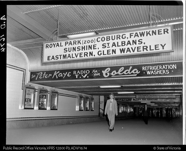 Degraves Street subway beyond the Flinders Street station turnstiles around about 1960.   The walls under the station platforms have the original 1901 cream coloured tiles, and the ceiling is corrugated tin