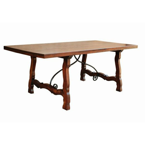 With Its Distinctly 19th Century Design And Intricate Iron Work This Dining Table Brilliantly Evokes