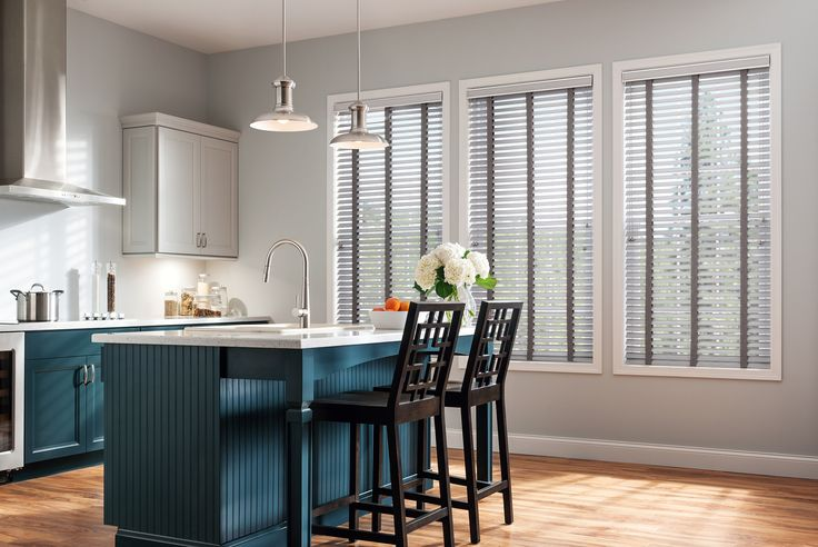 I really love how these blinds match the color scheme of this room. It would probably be good to consider the overall colors of a room before buying blinds. My sister is looking for some new blinds, so she'll have to consider what color to get them in.