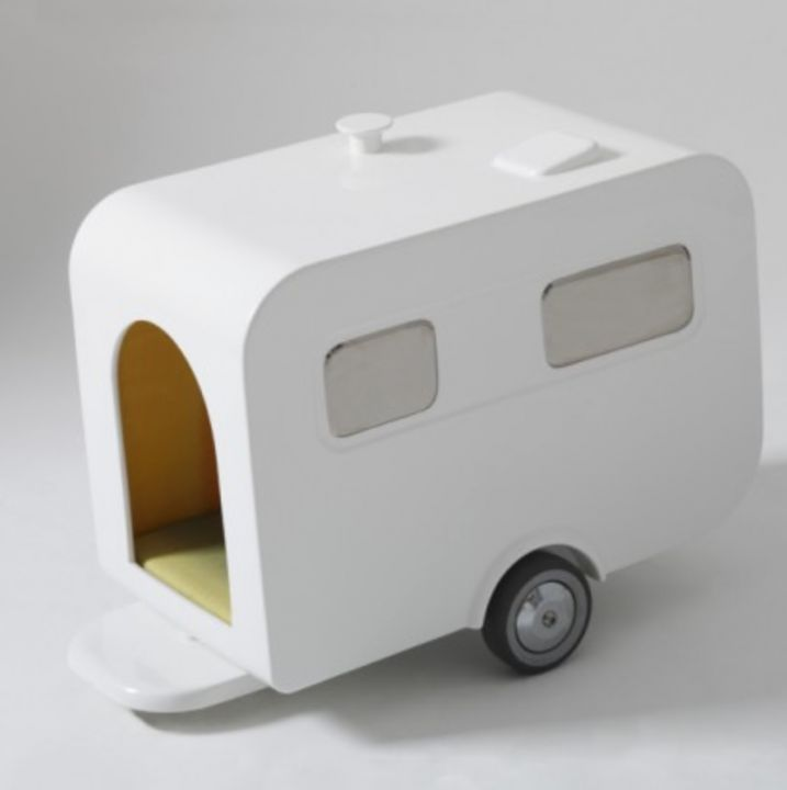 Wannekes, Caravan Dog House, $1,253 - Don't forget your pets' guests when outfitting their home. For a stay over like no other, consider THIS designer Caravan House by Marco Morosini. A backyard camping excursion for a team of dogs would really bring these ceramic models to life.  Photo credit: Marco Morosini